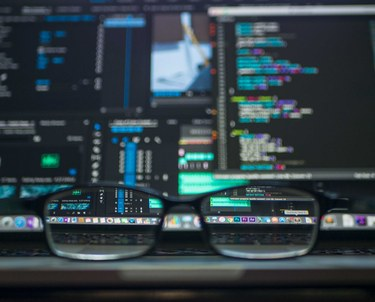 Glasses with computer screen in background