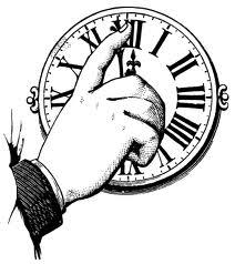 Hand Adjusting Time on an Antique Clock